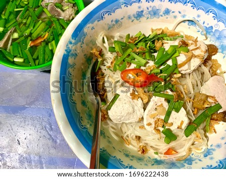 Vietnamese street food hu tiu go rice noodle bowl #1696222438