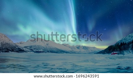 Northern lights (Aurora borealis) in the sky over Tromso, Norway #1696243591