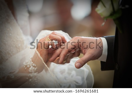 An unrecognizable bride and groom exchanging of the Wedding Rings in church during the christian wedding ceremony  #1696261681