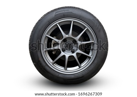 Closeup Wheel super car isolated on White background view. Move speed. Clipping path. Royalty-Free Stock Photo #1696267309