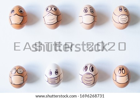 Diverse chicken eggs with doodle faces wearing medical masks. Conceptual image of Easter during Corona virus epidemic lockdown