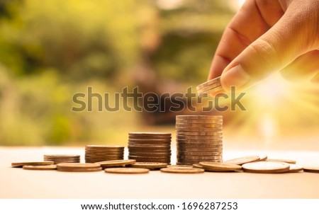 Human hands put silver coins into coins, financial concepts and business growth. #1696287253