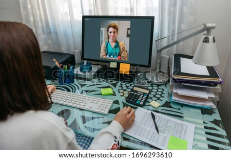 Unrecognizable woman talking on video call with computer with her doctor #1696293610