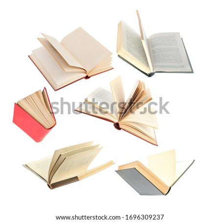 Old hardcover books flying on white background #1696309237