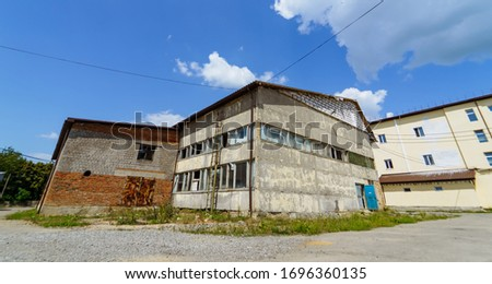 Abandoned building in the countryside on a sunny day. Rustic storehouse. #1696360135