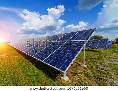 Production of solar panels. Green energy concept. Modern production factory or plant. Special equipment. #1696361650