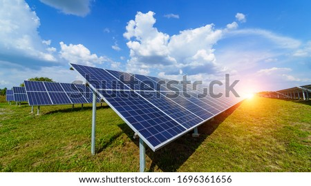 Solar panels on the sky background. Solar power plant. Blue solar panels. Alternative source of electricity. Solar farm. Royalty-Free Stock Photo #1696361656
