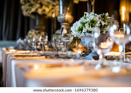 Luxury table settings for fine dining with and glassware, beautiful blurred  background. For events, weddings.  props for weddings, birthdays, and celebration. Wedding, restaurant, Royalty-Free Stock Photo #1696379380