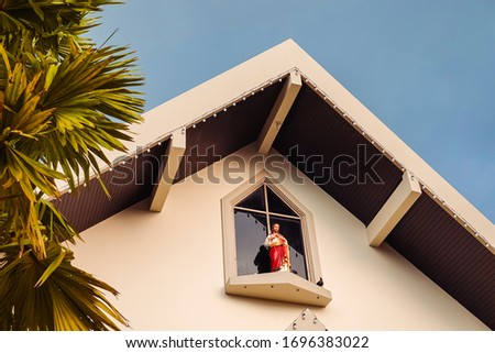 Picture of Jesus on the front Of the Christian church in Thailand