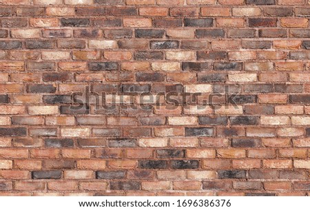 Grungy old red brick wall, seamless background texture, photo pattern