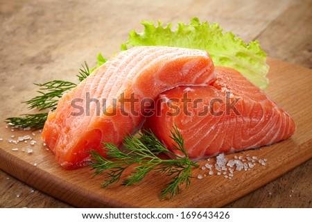 fresh raw salmon on wooden cutting board #169643426