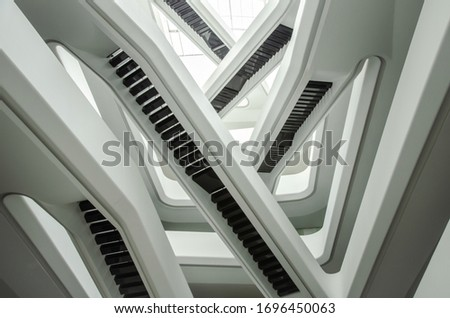 Moscow, Russia - 03.03.2020: white stairs and interior of a futuristic building in Moscow #1696450063