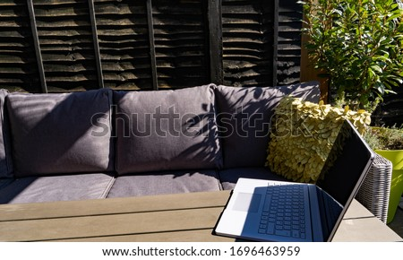 Summer working from home in the garden with debranded laptop and garden sofa set #1696463959