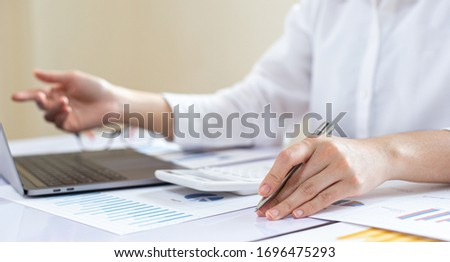 Financial business people are analyzing and examining Revenue - expense of real estate of the company, Financ and tax systems concept. #1696475293