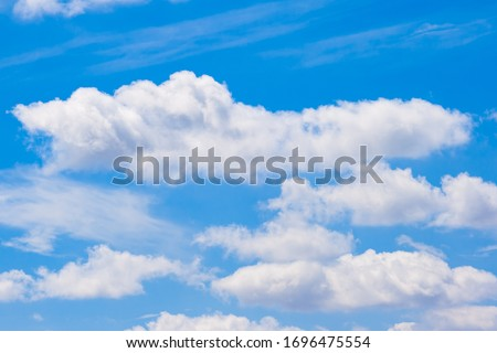 Scattered cloud clusters in a blue sky #1696475554