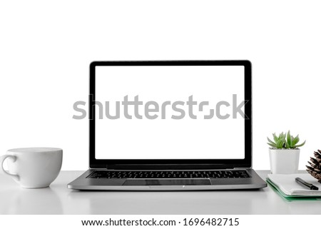 Mockup laptop devices isolated on white background. personal computer notebook white screen. and coffee cup, houseplant, notepaper as a desk Royalty-Free Stock Photo #1696482715