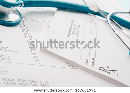 Medical documents (medical questionnaire, prescription and blood test) with a stethoscope on blue background #169651991