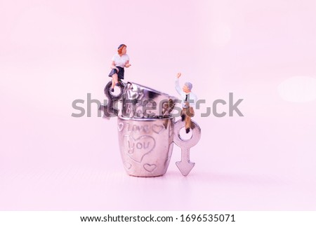 Miniature people: Man and woman, couple love. Image use for Living together, Valentine's day concept.