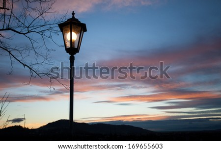 old lamps shining in sunset sky  #169655603