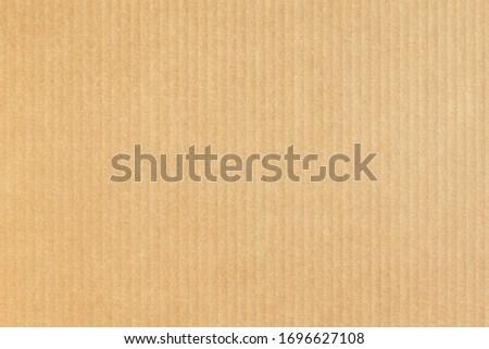 Kraft paper background. Cardboard texture. Carton. Royalty-Free Stock Photo #1696627108
