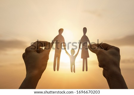 The concept of support and protection of the family. Royalty-Free Stock Photo #1696670203