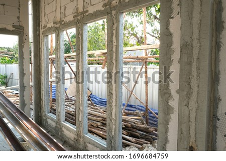 lightweight cement brick and white lintel plaster to joint for reinforce widow house frame in construction site. crack cement around window in hot day  #1696684759