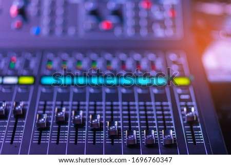 detail sound mixer in red and light ,Audio sound mixer console