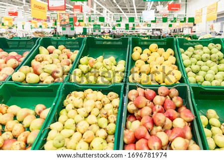 A variety of fruits in boxes in a large hypermarket. Healthy eating and vegetarianism.  #1696781974