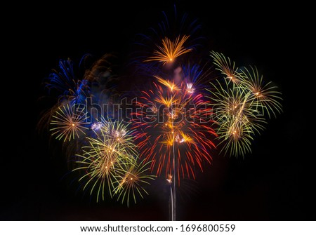 Fireworks of various colors bursting against a black background #1696800559