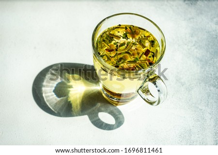 Healthy and organic food concept with floral and herb tea on stone background with copy space #1696811461