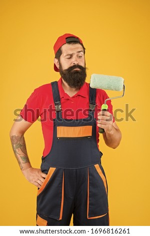 Painters work. Construction and renovation services. Decoration and decor. Perfect surface painting. Skillful painter. Bearded man painter on yellow background. Painting tool. Brush roller painter. #1696816261