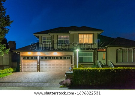 Luxury house at night in Vancouver, Canada. #1696822531