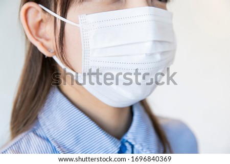 Asian woman wearing mask from nose to chin to prevent droplet infection #1696840369
