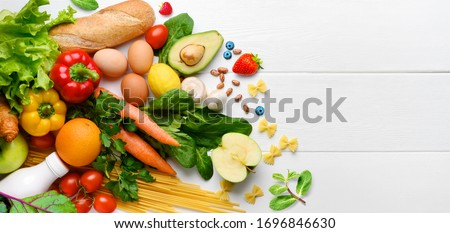 Healthy food background. Food photography different fruits and vegetables on white wooden table background. Copy space. Shopping food in supermarket