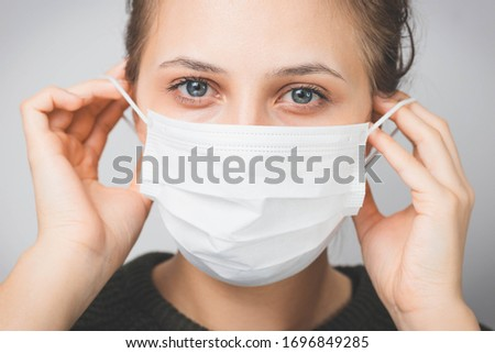 Woman wearing medical mask. Protection against viruses and infections. Stay home, corona virus. #1696849285
