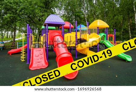 Kids playground closed due to COVID-19 coronavirus disease. SARS-CoV-2 corona virus pandemic, countries impose quarantine and restrictions during coronavirus pandemic. Lockdown and COVID concept. Royalty-Free Stock Photo #1696926568