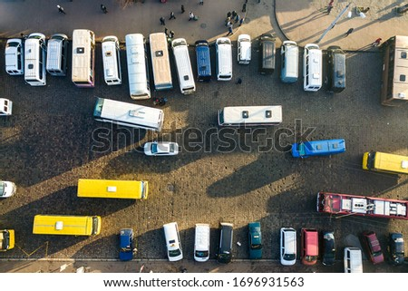 Aerial view of many cars and buses moving on a busy city street. #1696931563
