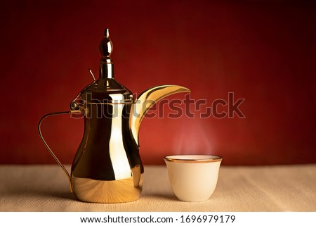 Ramadan - Arabian coffee with wallah on a red background Royalty-Free Stock Photo #1696979179