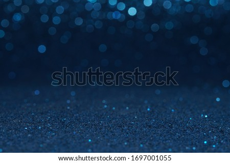 blue bokeh glitter texture christmas abstract background Royalty-Free Stock Photo #1697001055