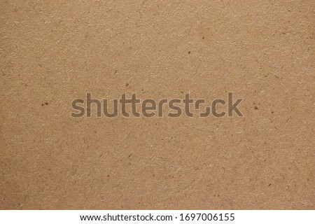 Brown cardboard sheet paper for design background Royalty-Free Stock Photo #1697006155