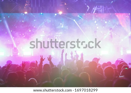 crowd with raised hands at concert festival #1697018299