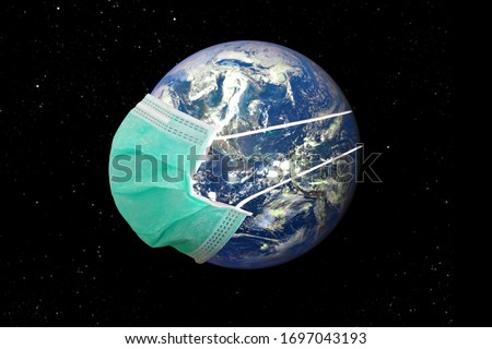 Planet Earth with face mask protect covid-19. World medical concept. Elements of this image furnished by NASA. #1697043193