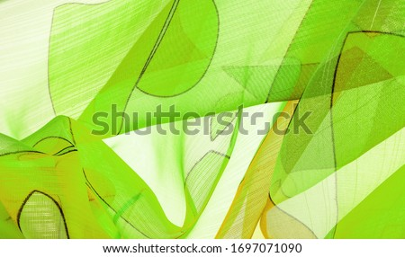 The background texture is an organza pattern - a light transparent fabric of fine knitwear, similar to a veil of fine viscose silk. green white yellow gray geometric colors #1697071090