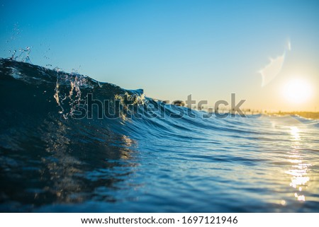 sunrise and waves at sea