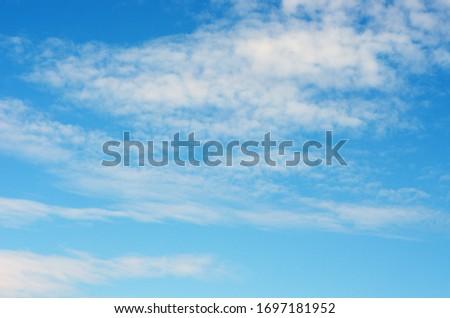 White clouds in blue sky #1697181952