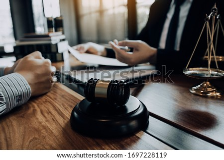 Clients come to seek advice for the law regarding privacy violations with the lawyer at the office. #1697228119
