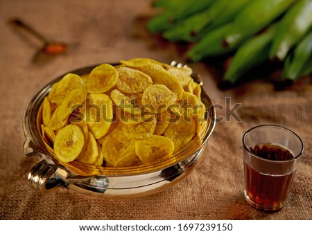 Kerala banana chips recipe with step by step pics. Kerala banana chips are crispy and tasty banana chips made with unripe nendran bananas and coconut oil. Its the frying in coconut oil and the firm te #1697239150