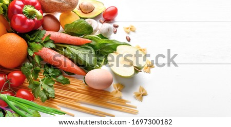 Healthy food background. Food photography different fruits and vegetables on white wooden table background. Copy space. Food shopping. #1697300182