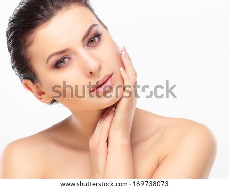 Beautiful Girl Touching Her Face. Isolated on a White Background. Perfect Skin. Beauty Face. Professional Makeup #169738073