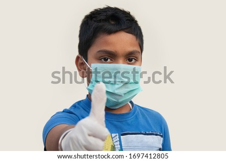 Boy wearing rubber glove And protective mask Pointing  #1697412805